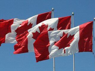 three canadian flags in the row